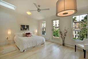 Contemporary Master Bedroom with Hardwood floors, Skylight, flush light, Standard height, French doors, Ceiling fan