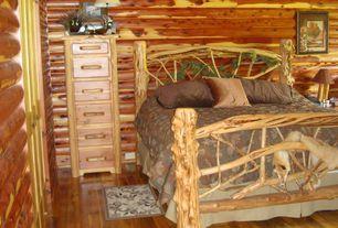 Rustic Guest Bedroom with specialty door, Hardwood floors