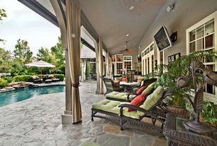 Tropical Porch with Wrap around porch, Pathway, Outdoor wicker furniture, Fountain, Transom window, French doors