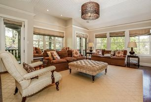Contemporary Living Room with High ceiling, double-hung window, flush light, Hardwood floors, can lights, French doors