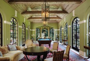 Mediterranean Game Room with Concrete floors, Pendant light, interior wallpaper, Exposed beam, Arched window, French doors