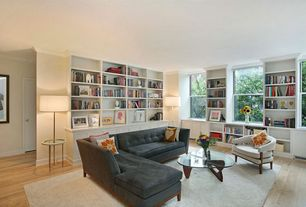 Modern Living Room with Hardwood floors, Built-in bookshelf, Crown molding