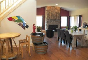 Eclectic Great Room with Standard height, Built-in bookshelf, stone fireplace, specialty window, Fireplace, Hardwood floors