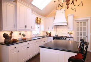 Traditional Kitchen with White subway tile, Pental black soapstone, Undermount sink, High ceiling, French doors, L-shaped