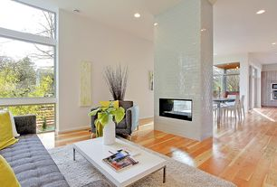 Modern Great Room with French doors, Florence style oatmeal wool armchair chair, Interstyle glasstints, Hardwood floors