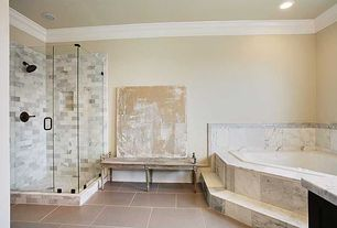 Contemporary Master Bathroom with Master bathroom, Crown molding, frameless showerdoor, Complex marble counters