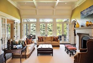 Traditional Living Room with can lights, Hardwood floors, French doors, Fireplace, Standard height, Crown molding