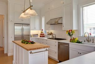 Traditional Kitchen with Corian counters, U-shaped, Flush, Pendant light, Kitchen island, European Cabinets, Subway Tile