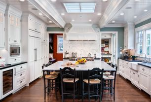 "Traditional Kitchen with European Cabinets, French doors, Calacatta Gold 12"" x 24"" Marble Tile, Kitchen island, Stone Tile"
