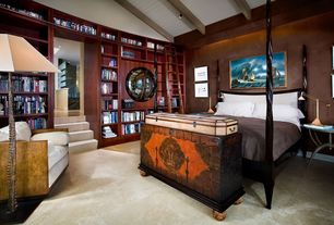 Eclectic Master Bedroom with High ceiling, Concrete floors, Exposed beam, can lights, Built-in bookshelf