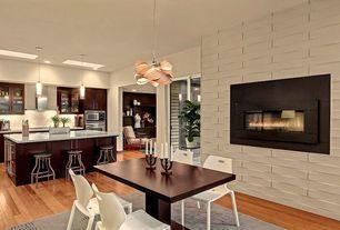 Modern Great Room with Pendant light, Chandelier, stone fireplace, Hardwood floors, Built-in bookshelf