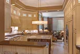Traditional Kitchen with Interior plantation shutters, Pendant light, Complex granite counters, Simple Granite Tile, U-shaped
