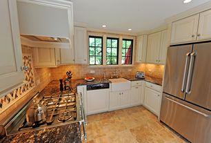 Traditional Kitchen with limestone tile floors, Paint 1, Farmhouse sink, U-shaped, Crown molding, full backsplash, dishwasher