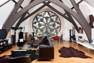 Eclectic Living Room with DYED CHOCOLATE BROWN COWHIDE RUG, Built-in bookshelf, Cathedral ceiling, Exposed beam