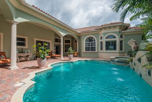Mediterranean Swimming Pool with exterior concrete tile floors, specialty window, Other Pool Type, Arched window, Fountain