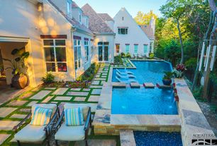Traditional Swimming Pool with Fence, exterior stone floors, French doors
