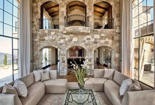 Contemporary Great Room with Stone county ironworks stratford coffee table, Chandelier, Hardwood floors, Interior stone wall