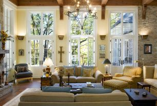 Traditional Living Room with Exposed beam, Interior brick wall, Paint 1, French doors, Brick interior wall, Casement