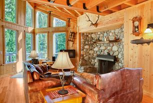 Rustic Living Room with Brandon distressed whiskey italian leather sofa and chair, stone fireplace, bedroom reading light