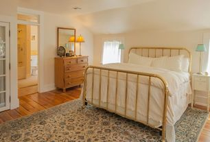 Traditional Master Bedroom with French doors, Transom window, Standard height, Hardwood floors