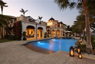 Mediterranean Swimming Pool with Stone pool deck, Exterior stucco, Palm trees, Indoor/outdoor living, Pool with hot tub