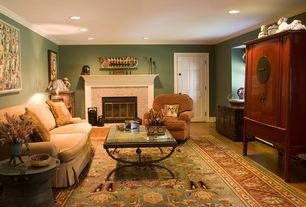 Traditional Living Room with Laminate floors, Cement fireplace, Crown molding, Built-in bookshelf