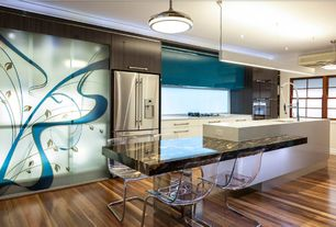 Contemporary Kitchen with Breakfast bar, Onyx counters, European Cabinets, Corian counters, Clear slide chair, One-wall