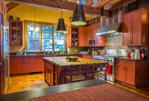 Craftsman Kitchen with Kitchen island, Stone Tile, Flush, Glass panel, Simple granite counters, Flat panel cabinets, U-shaped