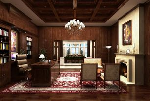 Traditional Home Office with Wall sconce, Built-in bookshelf, Sunken living room, Chandelier, High ceiling, Hardwood floors