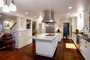 Traditional Kitchen with full backsplash, Soapstone counters, Glass panel, Crown molding, Flush, dishwasher, electric cooktop