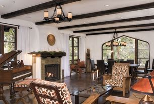Eclectic Great Room with Chandelier, stone fireplace, Exposed beam, Hardwood floors