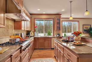Craftsman Kitchen with Undermount sink, L-shaped, Raised panel, Pendant light, Pottery Barn Adeline Rug, Crown molding