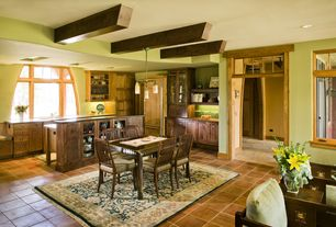 Craftsman Great Room with Pendant light, terracotta tile floors, Built-in bookshelf, Exposed beam