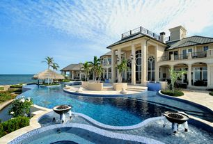 Tropical Swimming Pool with French doors, exterior stone floors, Fire pit, Pathway, Pool with hot tub, Infinity pool, Gazebo