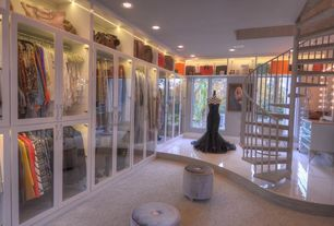 Traditional Closet with Built-in bookshelf, Standard height, Crown molding, simple marble floors, Casement, can lights