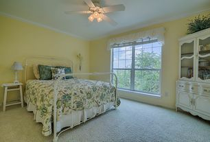 Traditional Guest Bedroom with Built-in bookshelf, Carpet, Crown molding, Standard height, double-hung window, Ceiling fan