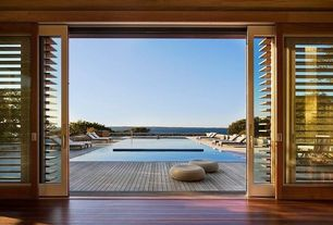 Contemporary Swimming Pool with Infinity pool, specialty window, sliding glass door, Alseda, Deck Railing