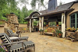 Rustic Patio with outdoor pizza oven, Outdoor kitchen, Raised beds, exterior stone floors, Casement