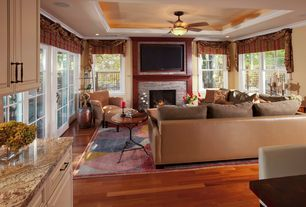Traditional Great Room with Crown molding light, Engineered hardwood flooring, Ceiling fan, Paint, Granite countertop
