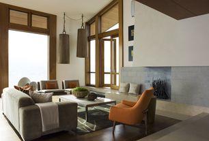 Contemporary Living Room with Sunken living room, French doors, Wainscotting, Hardwood floors, Transom window, Pendant light