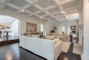 Traditional Living Room with Hardwood floors, Sunken living room, French doors, Single cushion sofa, Arched doorway, Paint