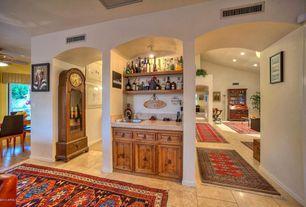 Mediterranean Bar with travertine tile floors, Built-in bookshelf, Standard height, flush light, stone tile floors