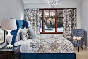 Contemporary Guest Bedroom with Carpet, specialty window, Chandelier, Built-in bookshelf, Standard height