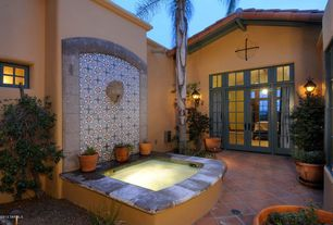 Mediterranean Patio with French doors, Transom window, exterior terracotta tile floors, exterior tile floors