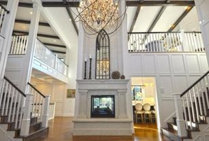 Traditional Entryway with Fireplace, Chandelier, stone fireplace, Hardwood floors, Columns, Exposed beam, High ceiling