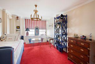 Traditional Kids Bedroom with Land of Nod Little Felix Chair Red, Henredon Chest, Crown molding, Carpet, Built-in bookshelf