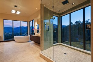 Contemporary Master Bathroom with Wall sconce, European Cabinets, Master bathroom, Pendant light, Vessel sink, Freestanding