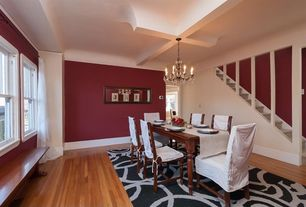 Traditional Dining Room with Window seat, Hardwood floors, Chandelier