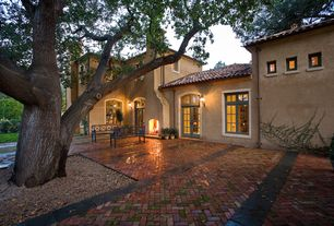 Mediterranean Patio with Transom window, French doors, exterior tile floors, Pathway, Arched window, exterior brick floors