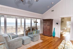 Cottage Living Room with Balcony, Ceiling fan, Double ceiling fan, Armchair, Waterfront, Crown molding, Area rug